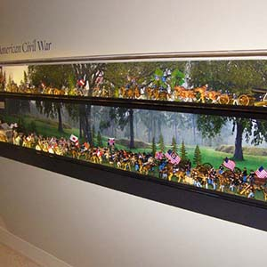 Custom wall-mounted cases outfitted with LEDs at the Frazier History Museum